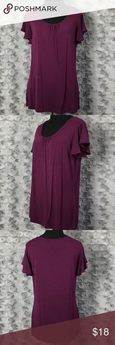 """Ann Taylor Factory Purple Top with Flutter Sleeves Brand:  Ann Taylor Factory Size:  M medium Fabric content:  96% rayon + 4% spandex Bust:  17"""" Waist:  18"""" Hips:  19"""" Length:  24.5"""" Sleeves/Straps:  3.25"""" + 4.25"""" Notes:  med/dark plum color short sleeve top;  flutter sleeves;  slight gathering at neckline;  hemline straight (front) & rounded (back) Ann Taylor Factory Tops"""