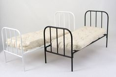 A simple metal bed available in white and black, perfect for the servant's room, includes a rustic cream mattress.Sold separately. 150mm x 79mm x 65mm