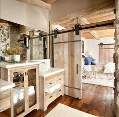 Wood floors and barn doors...Pretty Cool Bathroom and bedroom I need my own house. And now.