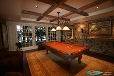Pool table room and custom cabinet to hold billiard cues.