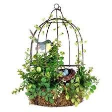 Would be cute on the porch. Two adorable lovebirds perch on a simple branch in this delightful and artistic accent piece, with pretty mosaic-style wings in bright blue and green hues with vibrant pops of pink. Bird Cage Centerpiece, Centerpieces, Birdcage Planter, Birdcage Decor, Bird Houses, Garden Art, Floral Arrangements, Farmhouse Decor, Diy Home Decor