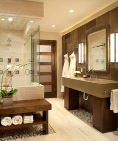 cozy, modern bathroom : flooring : layout : solid surface sink : shower