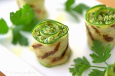 So easy and so good! Grilled Artichoke Pesto Zucchini Bites. Just spread grilled zucchini ribbons with artichoke pesto and serve!