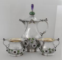Gustav Gaudernack design of art Nouveau David-Andersen Coffee pot, sugar bowl and cream jug.  Stylized leaf ornaments in green, black and white enamel. Amethysts on coffee pot lid and as part of ornaments. (Photo A.M. Vindedal)