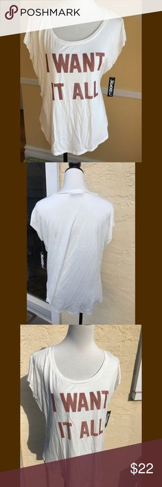 """NWT I WANT IT ALL Tee shirt Soft and lightweight cap sleeve tee in off white with brown lettering. 95% rayon 5% spandex. Machine wash cold, line or lay flat to dry. Oversized tee measures 22"""" from armpit to armpit, 22"""" from shoulder to hem. Get a head start on Spring, or if in warmer climate, enjoy this beauty now! MSRP $42.99 plus tax. Signorelli Tops Tees - Short Sleeve"""