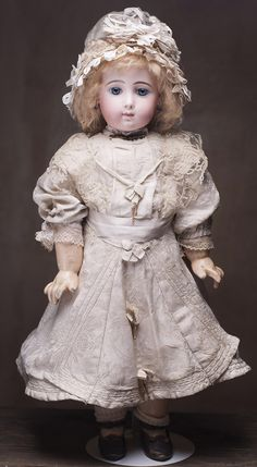 "22"" (56 cm) VERY BEAUTIFUL FRENCH BISQUE BEBE TRISTE BY JUMEAU IN RARE SIZE 10 Antique dolls at Respectfulbear.com"
