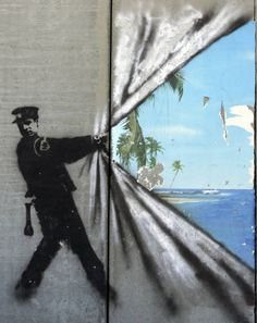 West Bank Street Art - Banksy In 2005, Banksy produced a series of striking and highly political ads commenting on the divide between the West Bank and Israel. Each piece touches on the concept of escapism or paradise on the other side of the wall.