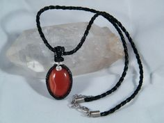 Woven wire wrapped Red Agate by NoStoneLeftUnturned on Etsy
