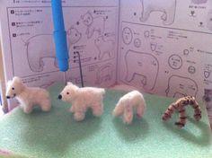needle felt polar bear in progress love how she made them into ornaments.