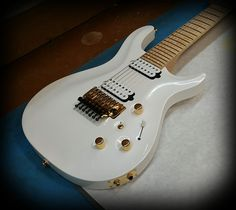 Kiesel Guitars Carvin Guitars CT74 (California Carved Top 7 String) in Diamond pearl white with gold hardware and Kiesel Lithium pick ups