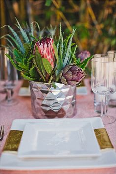 Succulents richly contrast with shiny silver vases for party centerpieces.
