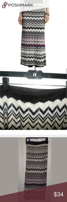 "WHBM Chevron Maxi Skirt Size Medium White House Black Market WHBM Chevron Maxi Skirt Shimmery Size Medium  Elastic waistband is a bit off kilter but can be straightened out  Beautiful for the holidays  W: 14.5"" L: 42""  Lined  94% Rayon 6% Other Fibers White House Black Market Skirts Maxi"