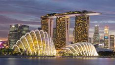 Singapore is home to two of the world's three most expensive buildings (including the three-towered Marina Bay Sands, pictured), a concert hall shaped like a durian and a museum shaped like a robotic hand. Architectural sightseeing part of the vacay! Singapore City, Visit Singapore, Singapore Travel, Machu Picchu, Beautiful Islands, Beautiful Places, Amazing Places, Holiday Destinations In India, Travel Destinations