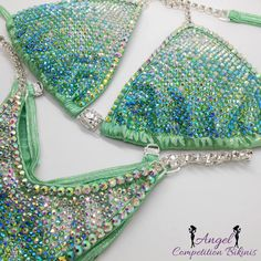 Custom design crystal ab, light pink ab, fuchsia ab and aqua ab on sequin turquoise with crystal trim