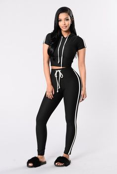 - Available in Black and Red - Striped Hoodie Set - Made in USA - 96% Polyester 4% Spandex Top: - Cropped - Hoodie with Drawstring - Striped Sides - Short Sleeve Bottom: - Straight Leg Legging - Draws