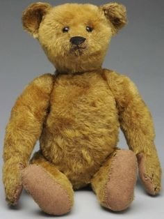 At Auction: April 27th. Early Steiff Mohair Teddy Bear. Lovely brassy color with black shoe button eyes, sewn nose, Steiff underlined Fs button in his ear; fully jointed with hump, long arms (replaced felt paw pads, slight fur loss on head and legs). Very appealing face! #Steiff #TeddyBear #MorphyAuctions