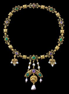The Kingfisher Necklace. British, c.1906. By John Paul Cooper (1869-1933), Gold, Emerald, Ruby, Pearl.  John Paul Cooper was one of the leading artist craftsmen who shared the medieval vision of William Burges. He was a luminary of the British Arts and Crafts movement and worked with Henry Wilson.