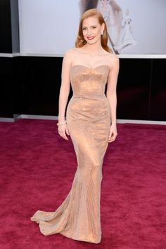 Jessica Chastain walked the red carpet in strapless Armani gown with Harry Winston jewels.