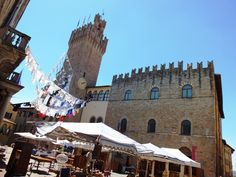 view of the Town Hall with stands of the antique market and hanging installation of contemporary art: ICASTICA