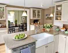 tan and white kitchen...looks clean and fresh! possible countertop.  Also could consider this color for walls