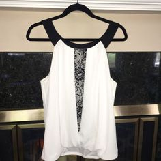 """LOWEST PRICE!⚡️Girly top with Black lace insert! This is a classy piece with the sexy black neckline and black lace set within the front of the top. Elastic bubble style waist which is slimming and goes with anything! Looks sophisticated with jeans or black pants and a chunky bracelet. Let this top do all the talking because it has all the """"details"""" Gently worn once and kept in pristine condition. Alyx Tops Blouses"""