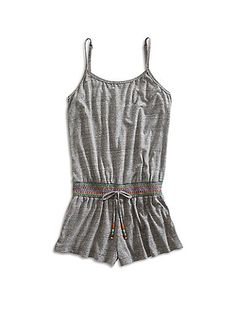 Essential romper featuring slim adjustable straps and a mock tie waist.