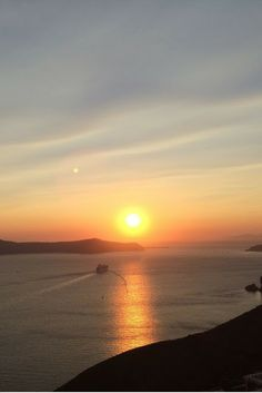 Sunset from Santorini Greece - Is Santorini worth it? Is this Greek island packed with blue buildings, stunning beaches and glorious sunsets that justify the price. The answer in pictures.