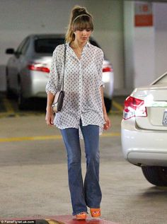Look at her glow: Jessica Alba looked casually stunning in a sheer white shirt on Friday as she stepped out in West Hollywood after a girls' night out