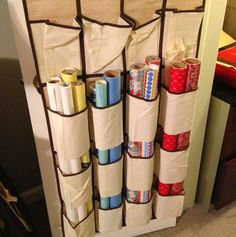With 12 Brilliant Holiday Storage Hacks DIY ● Wrapping Paper Organizer ● door shoe rack with bottoms cut out to hold wrapping paper.DIY ● Wrapping Paper Organizer ● door shoe rack with bottoms cut out to hold wrapping paper. Wrapping Paper Organization, Craft Organization, Craft Storage, Closet Organization, Shoe Storage, Dollar Store Organization, Wrapping Paper Holder, Organizing Tips, Organising