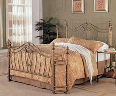 This beautiful iron bed will make a stunning centerpiece in your transitional style master bedroom. The bed has a high curved headboard and footb ...