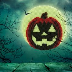 "This glow in the dark Jack-in-the-Moon is the perfect decoration for Halloween night! 10-1/2"" high. Designed by Kyle McCoy."