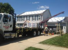 Willoughby Supply's two man unassisted rooftop delivery and disposal trailer
