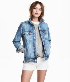 Light denim blue. Jacket in washed denim with distressed details. Buttons at front, chest pockets with flap and button, and side pockets. Buttons at cuffs