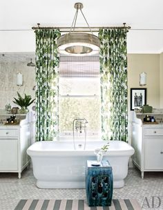 In a Los Angeles home, a leafy fabric by Peter Dunham Textiles lends a verdant vibe to the master bath