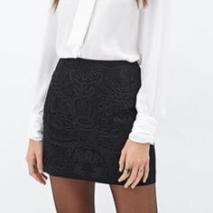 Black mini skirt New without tags, never worn. The design on the actual skirt is a little but different than the skirt on the model, but basically looks the same. Forever 21 Skirts Mini