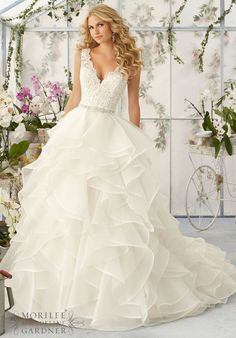 """Wedding Dresses and Wedding Gowns by Morilee featuring Venice Lace Appliques Sprinkled with Delicate Beading onto the Flounced Organza Skirt Removable Beaded Satin Belt. Available in Three Lengths: 55"""", 58"""", 61"""". Colors available:White, Ivory, Ivory/Light Gold, Ivory/Blush."""