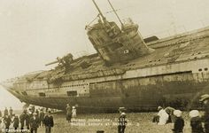 Haunting pictures show German warship washed onto beach after WWI as it sailed to France.