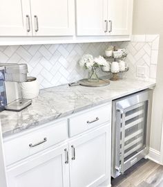 Pretty Backsplash, countertop and Cabinets. BUT... the backsplash should have ended at the cabinet not the countertop.
