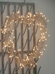 Xmas Heart Wreath all Aglow! .How simple to create- Fairy lights around a heart wire.