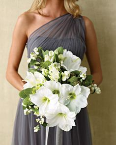 Glamorous Bouquet    Dewy, alabaster amaryllis is framed with viridiflora tulips, hellebores, round-leaf sage, and snowberries for texture.