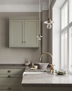 Nordiska Kök - The Classic Shaker kitchen is the natural heart of this beautiful home. Handmade in our carpentry in Gothenburg and handpainted in a pale sage green color, with a limestone countertop. More kitchen inspiration visit www. Classic Kitchen, Cute Kitchen, Shaker Kitchen, Kitchen Sink, Awesome Kitchen, Kitchen Soffit, Kitchen Cabinets, Ikea Kitchen, Kitchen Gadgets