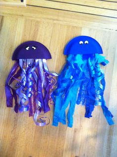 Ocean Themed First Birthday - Paper Plate Jelly fish  under the sea craft ribbon feathers fabric paint for eyes  More great things at www.dearmydaughters.com