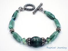 """""""Sherwood Forest""""  This gorgeous 8 inch bracelet has rare richly colored emerald/ forest green swirled German vintage beads, distinctive Bali silver bead caps.  Sale Price   $42  www.rejoicejewelry.com"""