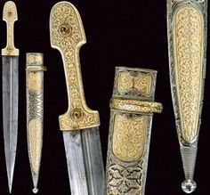 Kindjal, last quarter of the 19th c, straight blade with deep asymmetrical grooves, ivory grips inlaid with gold floral motif and gilded iron rivets, open work silver scabbard richly engraved and gilded with gold floral motifs and inset with ivory plaques decorated en suite with the hilt, inscriptions in Arabic, length 50 cm.