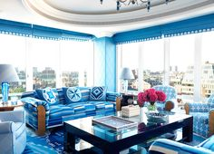 Beautiful blue room - looks very inviting!  Maybe a bit bright - needs a little more white!