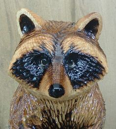 Chainsaw carving of Raccoon Close Up Face