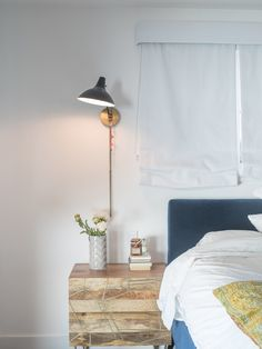 """A downstairs guest bedroom is a welcome retreat for visitors. """"Because I do so much traveling, if someone comes to stay, I want them to feel they can just be,"""" says Lena. The Roar   Rabbit brass-inlaid nightstand is from West Elm."""