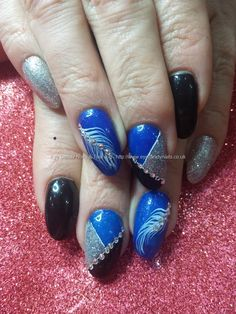 Electric blue gel with black, freehand nail art and swarovski crystals