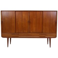 Danish Mid-Century Modern Teak Sideboard or Credenza by Omann Jun | From a unique collection of antique and modern sideboards at https://www.1stdibs.com/furniture/storage-case-pieces/sideboards/