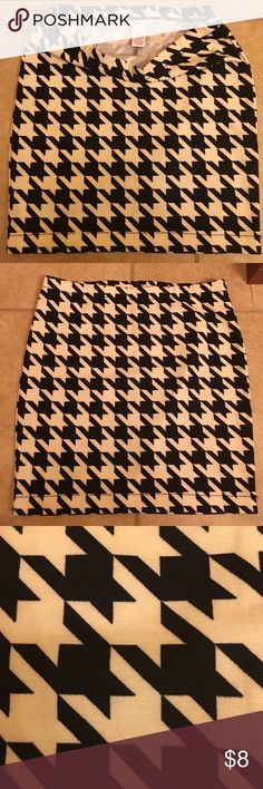 Mini skirt- soft houndstooth- super cute! Never worn, but tags are gone . Fall winter fashion forward Candie's Skirts Mini
